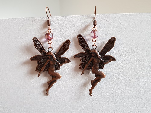 Cute earrings with fairies in copper color