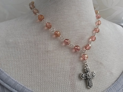 Cross necklace with a chain of sparkling Czech glass beads