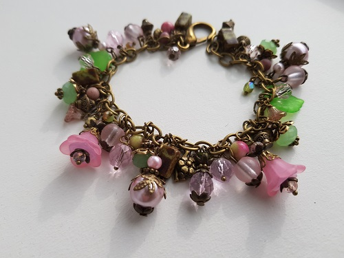 Green pink and bronze colored glass beads stones metal cluster b