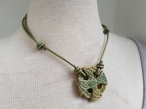 Green Celtic cross in stoneware clay green leather necklace