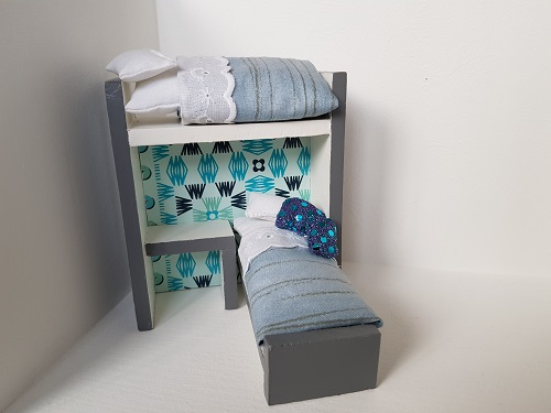 Miniature bunk bed dollhouse in blue